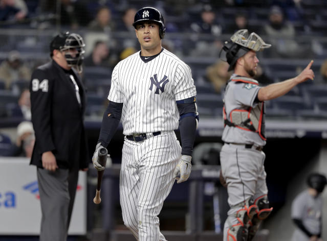 New York Yankees' Giancarlo Stanton walks back to the dugout after striking out against the Miami Marlins during the seventh inning of a baseball game, Monday, April 16, 2018, in New York. (AP Photo/Julie Jacobson)