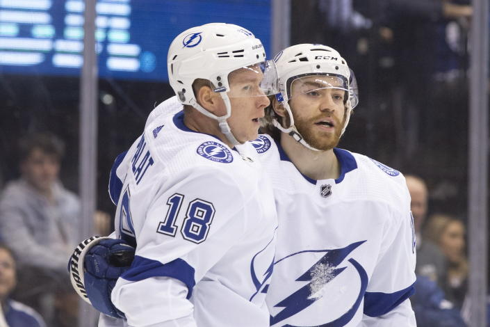 Tampa Bay Lightning left wing Ondrej Palat (18) celebrates with center Brayden Point (21) after scoring against the Toronto Maple Leafs during the second period of an NHL hockey game Tuesday, March 10, 2020, in Toronto. (Chris Young/The Canadian Press via AP)