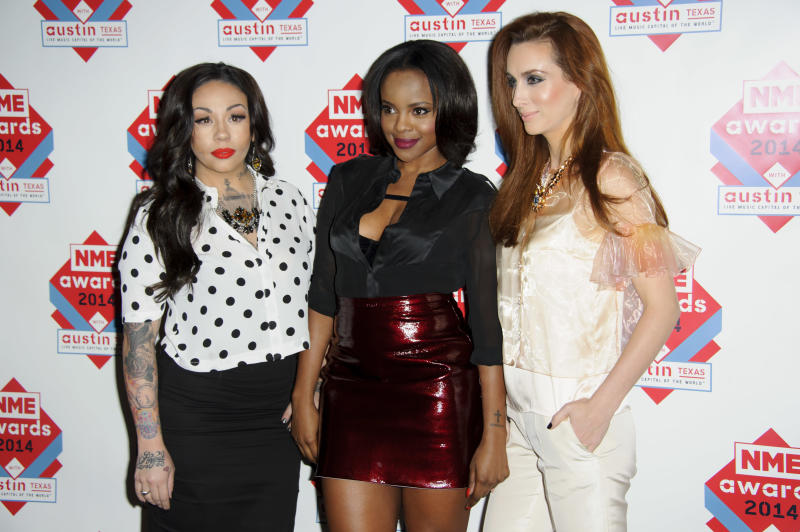 From left Siobhán Donaghy, Mutya Buena and Keisha Buchanan from British band Mutya Keisha Siobhan arrive for the NME Awards 2014 at a central London venue, London, Wednesday, Feb. 26, 2014. (Photo by Jonathan Short/Invision/AP)