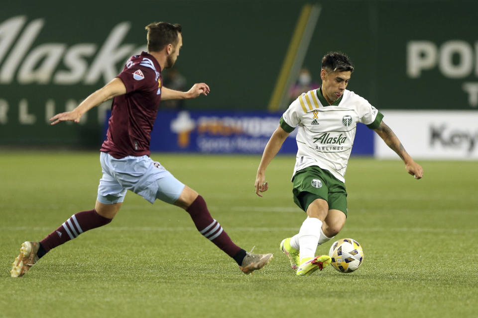 Portland Timbers forward Felipe Mora, right, navigates around a Colorado Rapids defender during an MLS soccer match, Wednesday, Sept. 15, 2021 in Portland, Ore. (Sean Meagher/The Oregonian via AP)