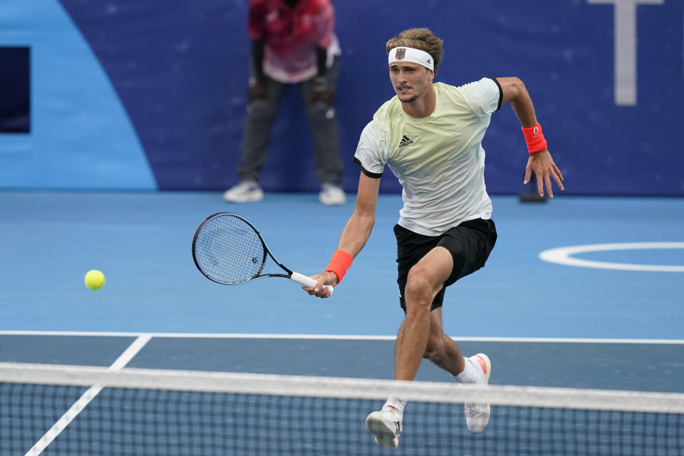 Alexander Zverev, of Germany, returns to Novak Djokovic, of Serbia, during the semifinal round of the men's tennis competition at the 2020 Summer Olympics, Friday, July 30, 2021, in Tokyo, Japan. (AP Photo/Patrick Semansky)