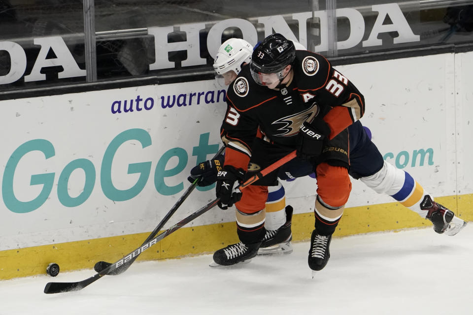 Anaheim Ducks' Jakob Silfverberg (33), of Sweden, fights for the puck with St. Louis Blues' Jaden Schwartz during the second period of an NHL hockey game Saturday, Jan. 30, 2021, in Anaheim, Calif. (AP Photo/Jae C. Hong)
