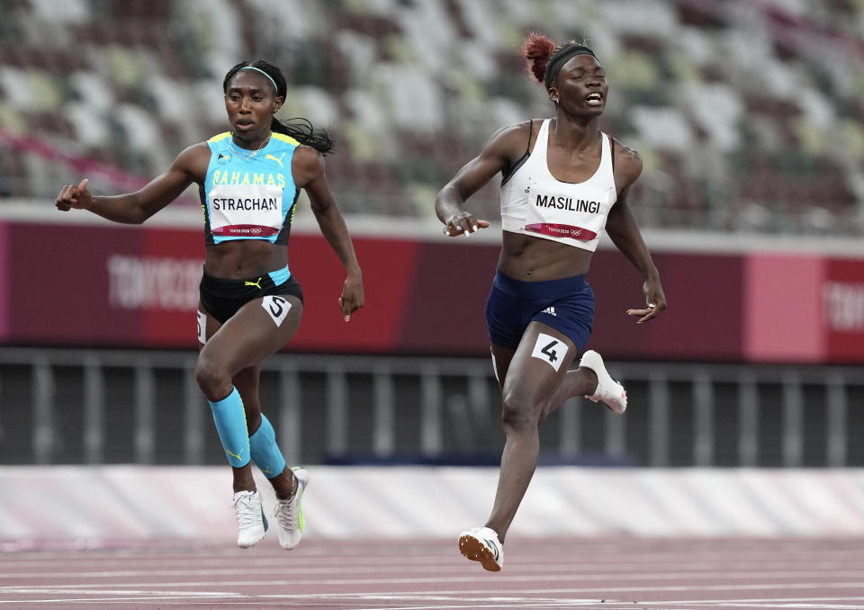 Anthonique Strachan, of Bahamas and Beatrice Masilingi, of Namibia compete in a women's 200-meter semifinal at the 2020 Summer Olympics, Monday, Aug. 2, 2021, in Tokyo, Japan. (AP Photo/Martin Meissner)
