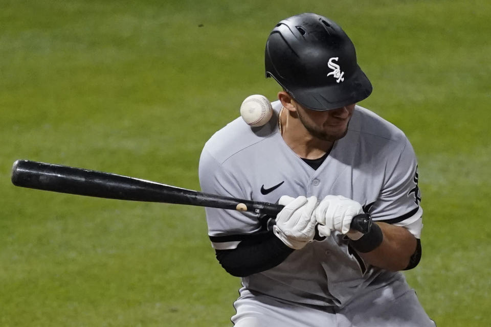 Chicago White Sox's Nick Madrigal is hit by a pitch from Los Angeles Angels relief pitcher Raisel Iglesias during the ninth inning of a baseball game Sunday, April 4, 2021, in Anaheim, Calif. (AP Photo/Ashley Landis)