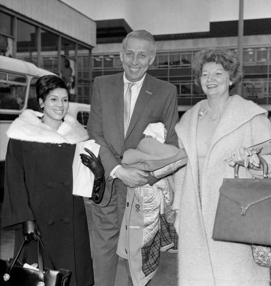 American bandleader Stan Kenton with Jean Turner, left and manager Margaret Sharpe, after arriving at London airport from New York for his second concert tour of Britain, Nov. 15, 1963. (AP Photo)