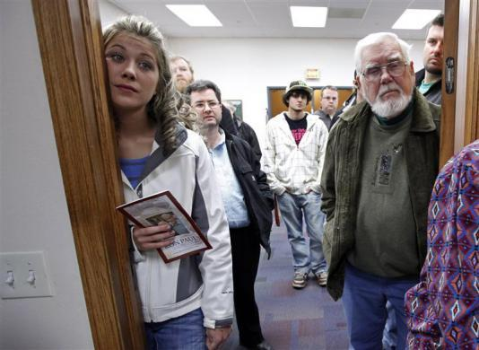 Ron Paul look on from the doorway into a Town Hall meeting at the Ericson Public Library during a campaign stop in Boone, Iowa, December 8, 2011. (REUTERS/Jim Young)