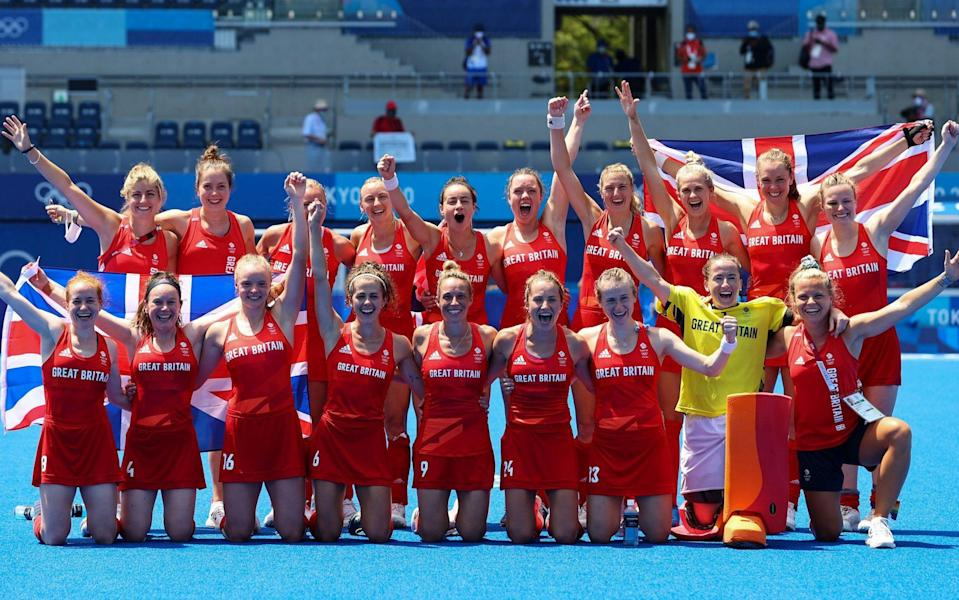 One for the mantelpiece - the squad celebrate having won the bronze at a hot and humid Oi Hockey Stadium - REUTERS