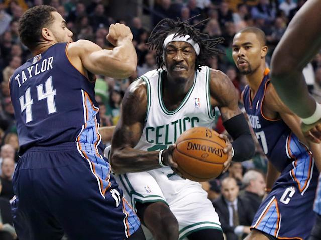 Boston Celtics small forward Gerald Wallace, center, drives against Charlotte Bobcats guards Jeff Taylor (44) and Ramon Sessions in the first quarter of an NBA basketball game in Boston, Wednesday, Nov. 13, 2013. (AP Photo/Elise Amendola)