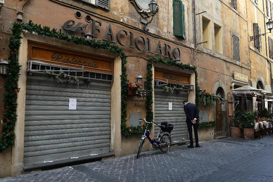 """Italian restaurant """"Er Faciolaro"""" near the Pantheon in Rome was closed by police as part of an anti-mafia operation in March (AFP Photo/Tiziana Fabi)"""
