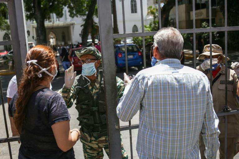Venezuela has 17 reported coronavirus cases, and Maduro has ordered a lockdown in the capital Caracas and six other states (AFP Photo/Cristian Hernandez)