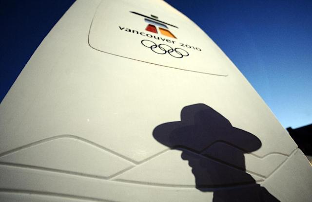 The IOC has ordered the re-testing of more than 1,000 samples taken during the 2010 Olympics in Canada The shadow of a Canadian police officer is seen on the torch in Whistler during the Vancouver Winter Olympics on February 14, 2010. AFP PHOTO / FRANCK FIFE (AFP Photo/FRANCK FIFE)