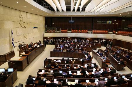 Israeli lawmakers attend a vote on a bill at the Knesset, the Israeli parliament, in Jerusalem February 6, 2017. REUTERS/Ammar Awad