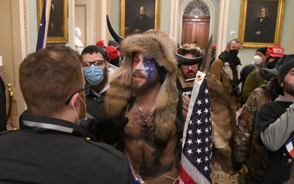 Supporters of US President Donald Trump enter the US Capitol on January 6 - SAUL LOEB/AFP via Getty Images