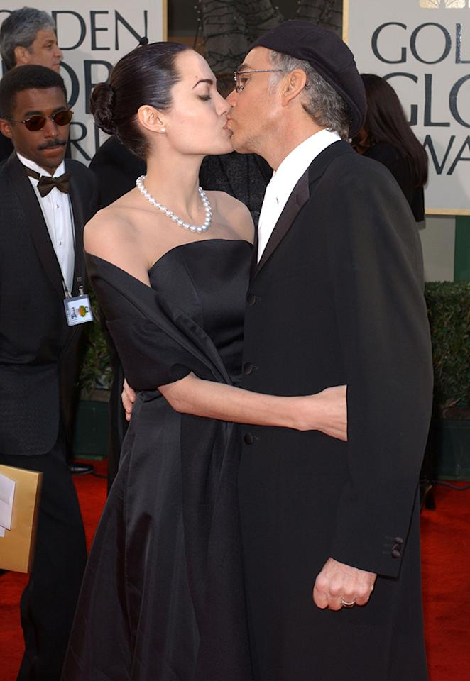 <p>Double nominee Thornton kisses then-wife Jolie on the red carpet. (Photo: Vince Bucci/Getty Images) </p>