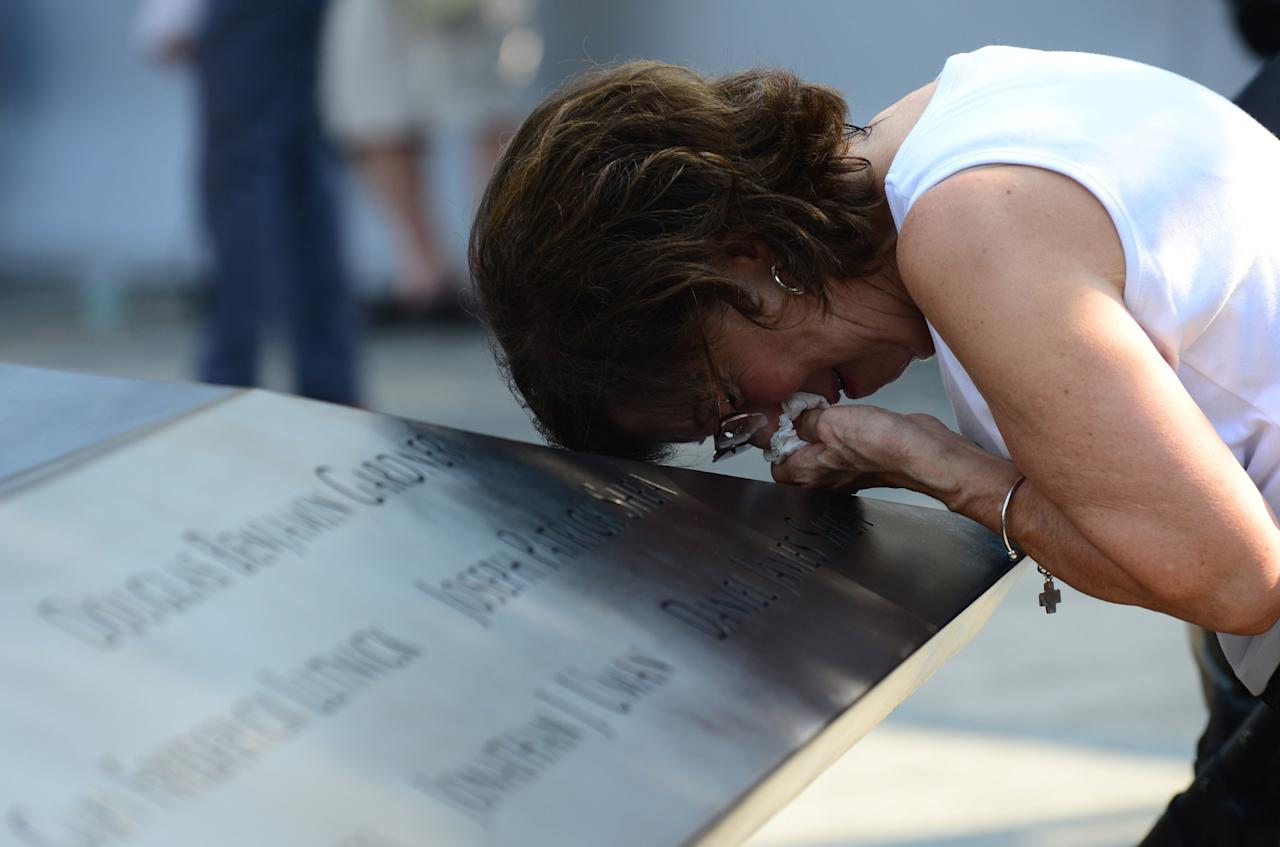 Geraldine Davie of Pelham, New York, cries after viewing name of her 23-year-old daughter Amy O'Doherty who was killed in the 9/11 World Trade Center attacks, during a ceremony marking the 12th anniversary of the event in New York September 11, 2013. REUTERS/  David Handschuh/Pool (UNITED STATES - Tags: DISASTER ANNIVERSARY)