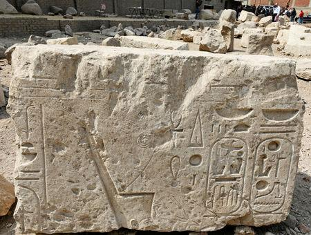 A part of an ancient Egyptian obelisk unearthed on Thursday is seen in the Matariya area in Cairo