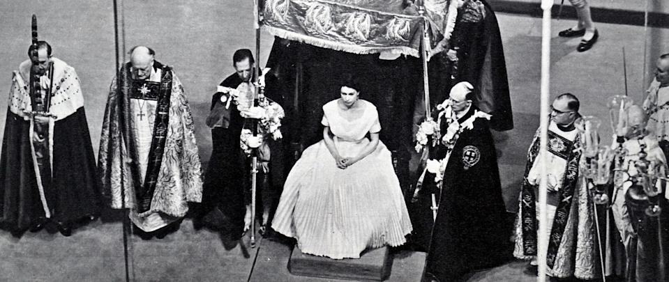 coronation of Elizabeth II of the United Kingdom. took place on 2 June 1953 at Westminster Abbey. London. Queen Elizabeth II. with the Duke of Edinburgh. at Buckingham Palace shortly after their return from Westminster Abbey. (Photo by: Universal History Archive/Universal Images Group via Getty Images)