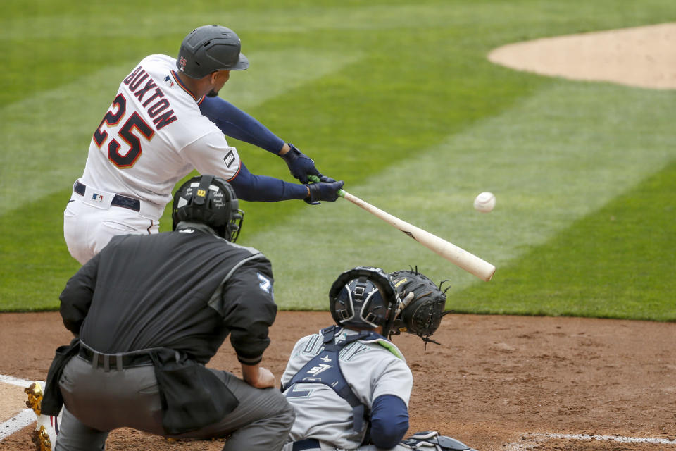 Minnesota Twins' Byron Buxton hits a two-run double against the Seattle Mariners in the third inning of a baseball game Sunday, April 11, 2021, in Minneapolis. (AP Photo/Bruce Kluckhohn)