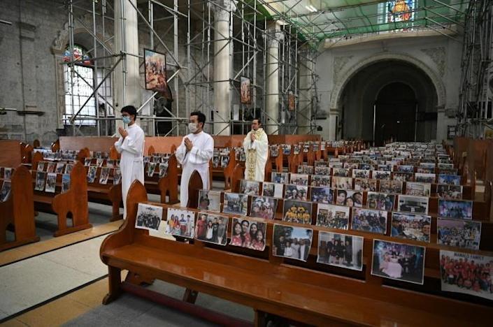 Filipinos emailed photographs to be attached to church pews for Easter services at the Holy Rosary church in Angeles City (AFP Photo/Ted ALJIBE)