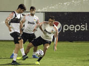 Valencia players train during a training session in Jiddah, Saudi Arabia, Tuesday, Jan. 7, 2020. Valencia will play the Spanish Super Cup semifinal soccer match against Real Madrid at King Abdullah stadium in Jiddah tomorrow. (AP Photo/Amr Nabil)