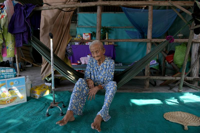Pham Thi Ca, 99, was offered money to move from her home in Vietnam as authorities hoovered up land for a planned $2.6 billion Japanese-funded coal plant (AFP Photo/-)