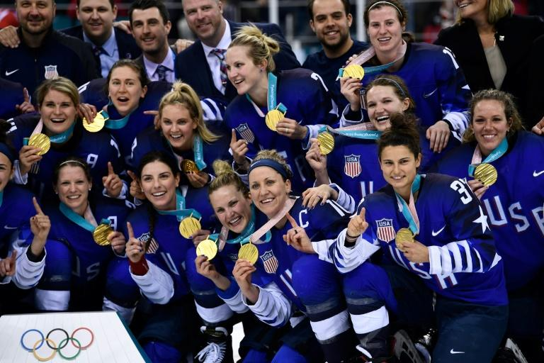 The US gold medal team celebrate after beating Canada to win their first women's Olympic ice hockey title in 20 years during the 2018 Winter Olympic Games