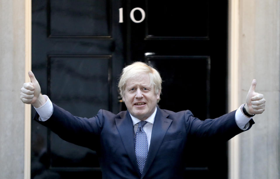 "Britain's Prime Minister Boris Johnson shows thumbs up before he applauds on the doorstep of 10 Downing Street in London during the weekly ""Clap for our Carers"" Thursday, April 30, 2020. The COVID-19 coronavirus pandemic has prompted a public display of appreciation for care workers. The applause takes place across Britain every Thursday at 8pm local time to show appreciation for healthcare workers, emergency services, armed services, delivery drivers, shop workers, teachers, waste collectors, manufacturers, postal workers, cleaners, vets, engineers and all those helping people with coronavirus and keeping the country functioning while most people stay at home in the lockdown. (AP Photo/Kirsty Wigglesworth)"