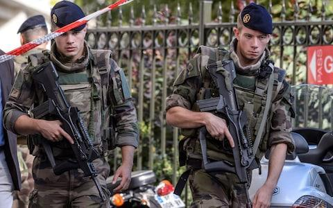 Military officers set up a security perimeter near the site - Credit: EPA/CHRISTOPHE PETIT TESSON