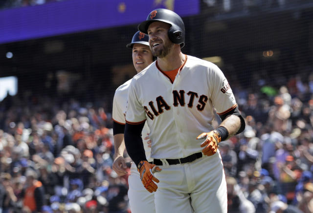 San Francisco Giants' Evan Longoria, right, smiles in front of teammate Buster Posey after Longoria's three-run home run during the first inning of a baseball game against the Los Angeles Dodgers Sunday, April 29, 2018, in San Francisco. (AP Photo/Marcio Jose Sanchez)