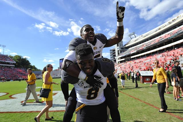 Missouri running back Marcus Murphy (6) gets a piggy back ride from wide receiver Darius White (8) while celebrating after their 41-26 win over Georgia in an NCAA college football game against Missouri Saturday, Oct. 12, 2013 in Athens, Ga. (AP Photo/Athens Banner-Herald, AJ Reynolds)