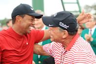 Tiger Woods of the United States embraces his chief spokesperson, Glenn Greenspan, as he comes off the 18th hole in celebration of his win during the final round of the Masters at Augusta National Golf Club on April 14, 2019 in Augusta, Georgia. (Photo by Andrew Redington/Getty Images)