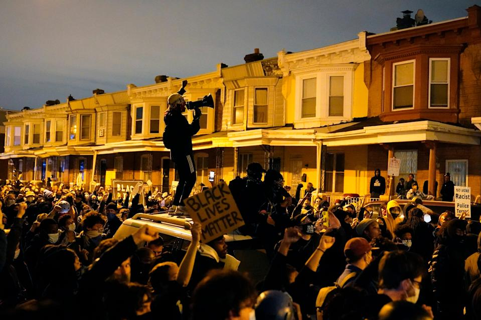 A demonstrator uses a megaphone during a march Tuesday Oct. 27, 2020 in Philadelphia.