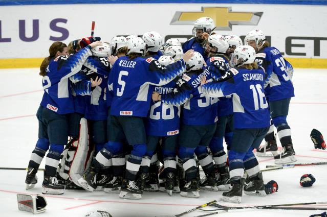 US players celebrate their 2-1 shootout victory after the IIHF Women's Ice Hockey World Championships final match between the United States and Finland in Espoo, Finland, on Sunday, April 14, 2019. (Mikko Stig/Lehtikuva via AP)
