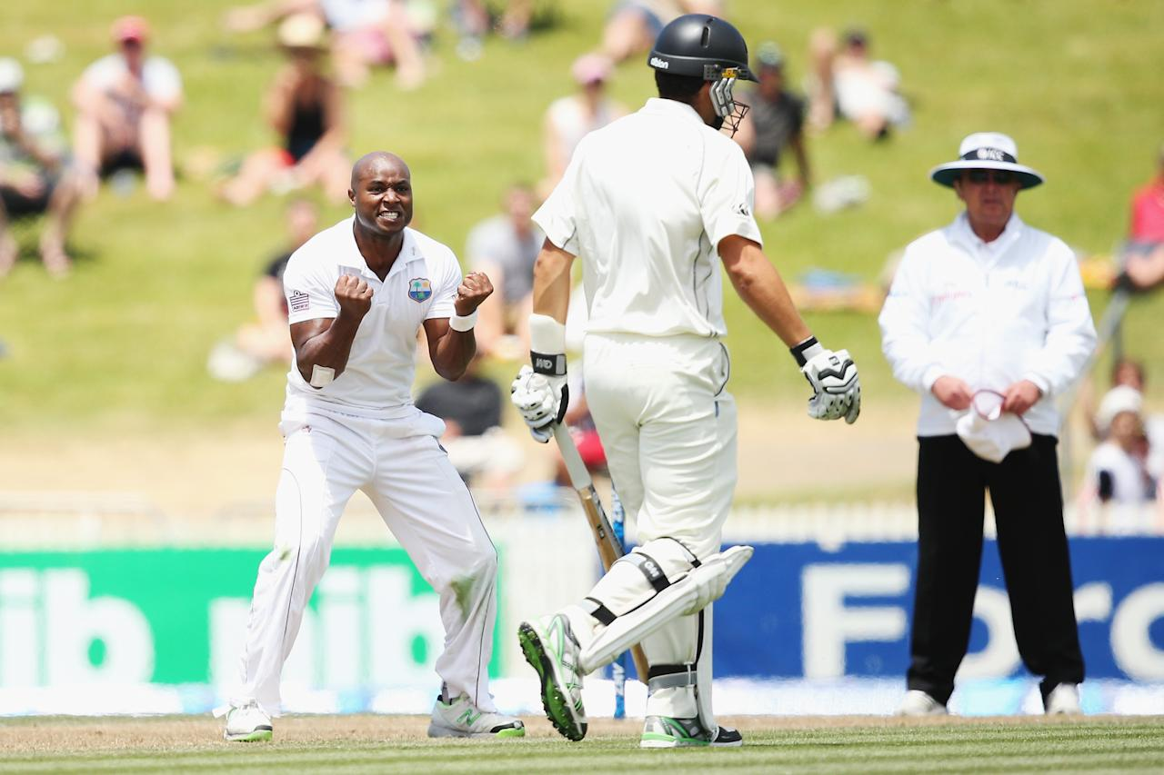 HAMILTON, NEW ZEALAND - DECEMBER 21: Tino Best of the West Indies celebrates the wicket of Ross Taylor of New Zealand during day three of the Third Test match between New Zealand and the West Indies at Seddon Park on December 21, 2013 in Hamilton, New Zealand.  (Photo by Hannah Johnston/Getty Images)