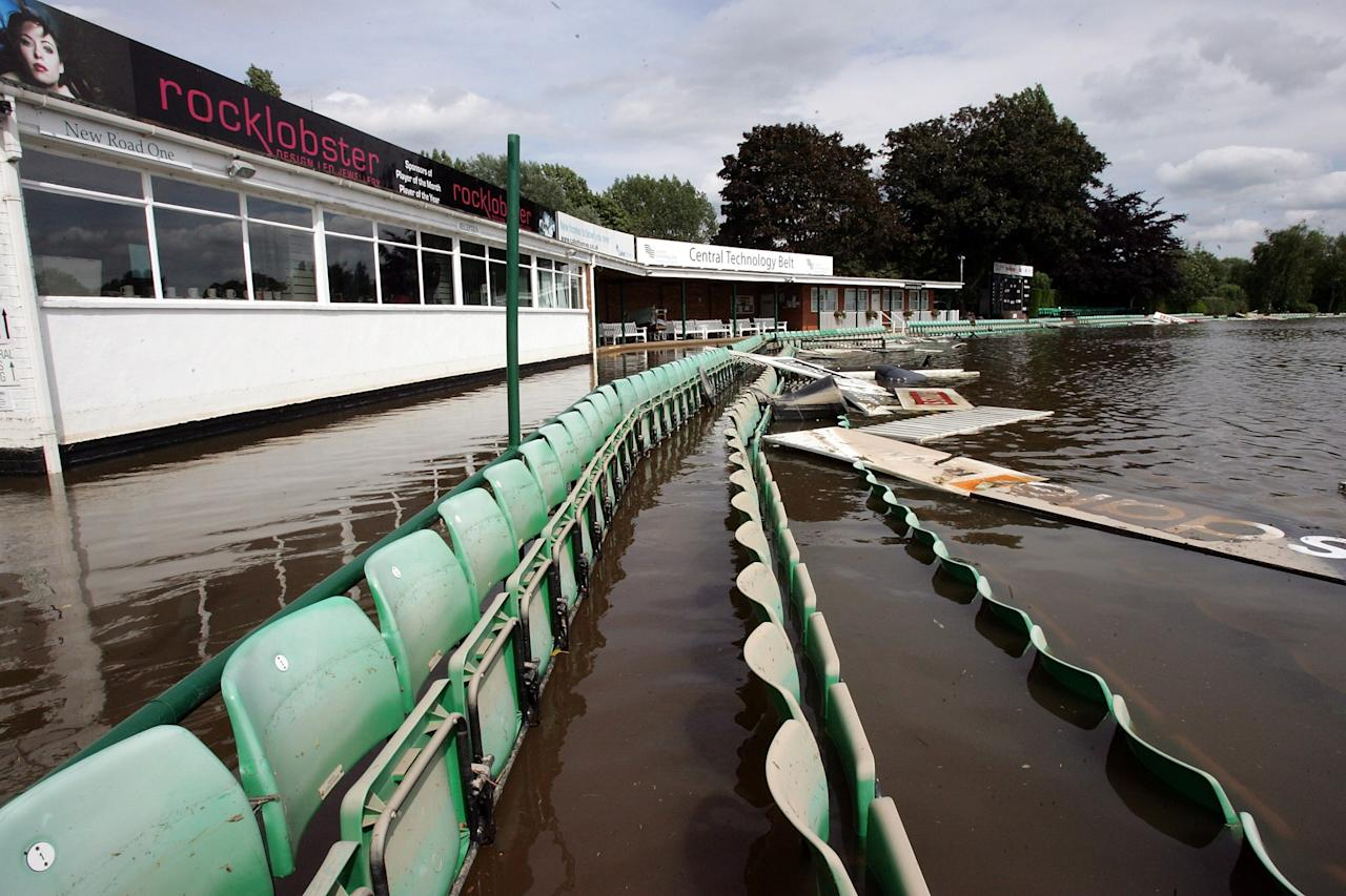 WORCESTER, UNITED KINGDOM - JUNE 28:  Debris floats in the flood water at Worcestershire Cricket Ground, on June 28, 2007 in Worcester, England. The Met Office has issued weather warnings of very heavy rain for the weekend leading to more flooding and continued disruption.  (Photo by Matt Cardy/Getty Images)