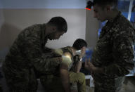 An Armenian wounded soldier receives treatment in a military hospital near the frontline in the separatist region of Nagorno-Karabakh, Sunday, Oct. 25, 2020. Armenia and Azerbaijan have accused each other of violating the new U.S.-brokered cease-fire aimed to halt the fighting over the separatist region of Nagorno-Karabakh. (AP Photo)