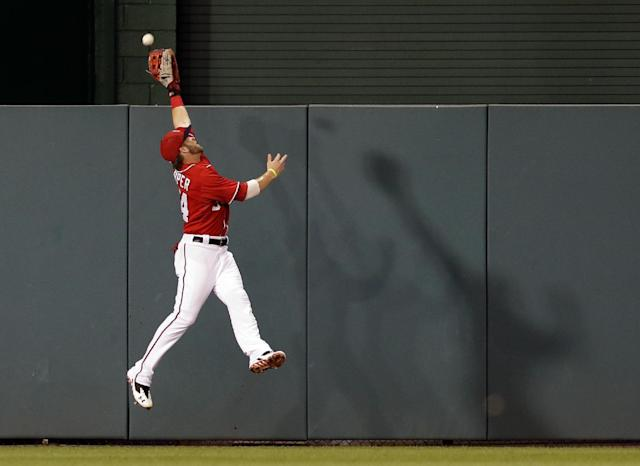 Washington Nationals center fielder Bryce Harper (34) can't catch a ball hit by New York Mets' Josh Satin (13) during the third inning of a baseball game at Nationals Park, Sunday, Sept. 1, 2013, in Washington. (AP Photo/Alex Brandon)