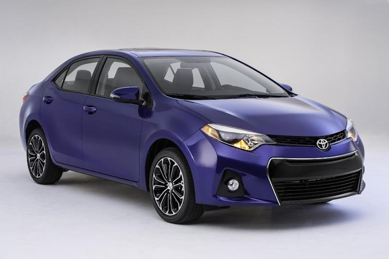 FILE - This June 6, 2013 product publicity image provided by Toyota shows the company's new Corolla revealed in Santa Monica, Calif. Ford on Wednesday, Oct. 23, 2013 claimed the top-selling car in the world crown for its Focus compact during the first half of the year based on registration data gathered by the R.L. Polk & Co. research firm, beating out the perennial No. 2 Corolla. Toyota disputes Ford's claim, saying it sold a Corolla hatchback under the Matrix name, and it sells cars that are nearly identical to the Corolla under different names in countries outside the U.S. Ford doesn't tally Toyota's other nameplates in its count. Toyota has contended that if all the other nameplates are added in, the Corolla is the winner. (AP Photo/Toyota, File)