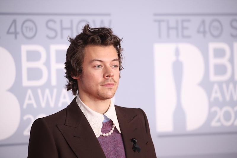 Harry Styles arrives on the Brit Awards red carpet.