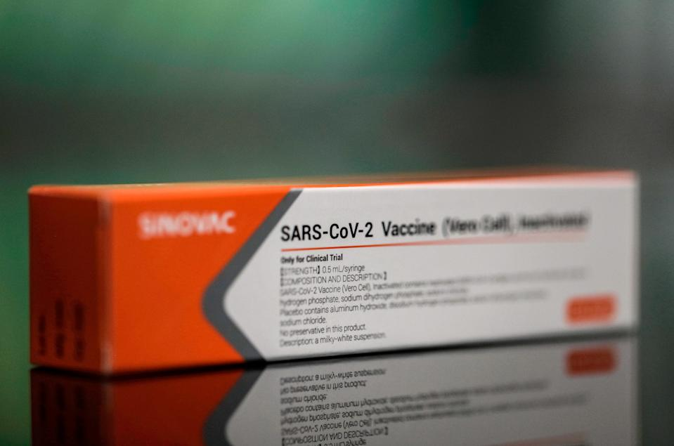SAO PAULO, BRAZIL - NOVEMBER 19: In this photo illustration, a box of Sinovac Biotech coronavirus trial vaccine is displayed at Palacio Bandeirantes on November 19, 2020 in Sao Paulo, Brazil. The batch with the first 120,000 doses of the CoronaVac vaccine arrived in Sao Paulo today. The material imported from China is being developed by the Chinese laboratory Sinovac, in partnership with the Butantan Institute. CoronaVac is one of four candidates for the vaccine against coronavirus that are being tested in Brazil, but has not yet had authorization from the National Health Surveillance Agency (Anvisa) to be applied in Brazil. (Photo by Rodrigo Paiva/Getty Images)