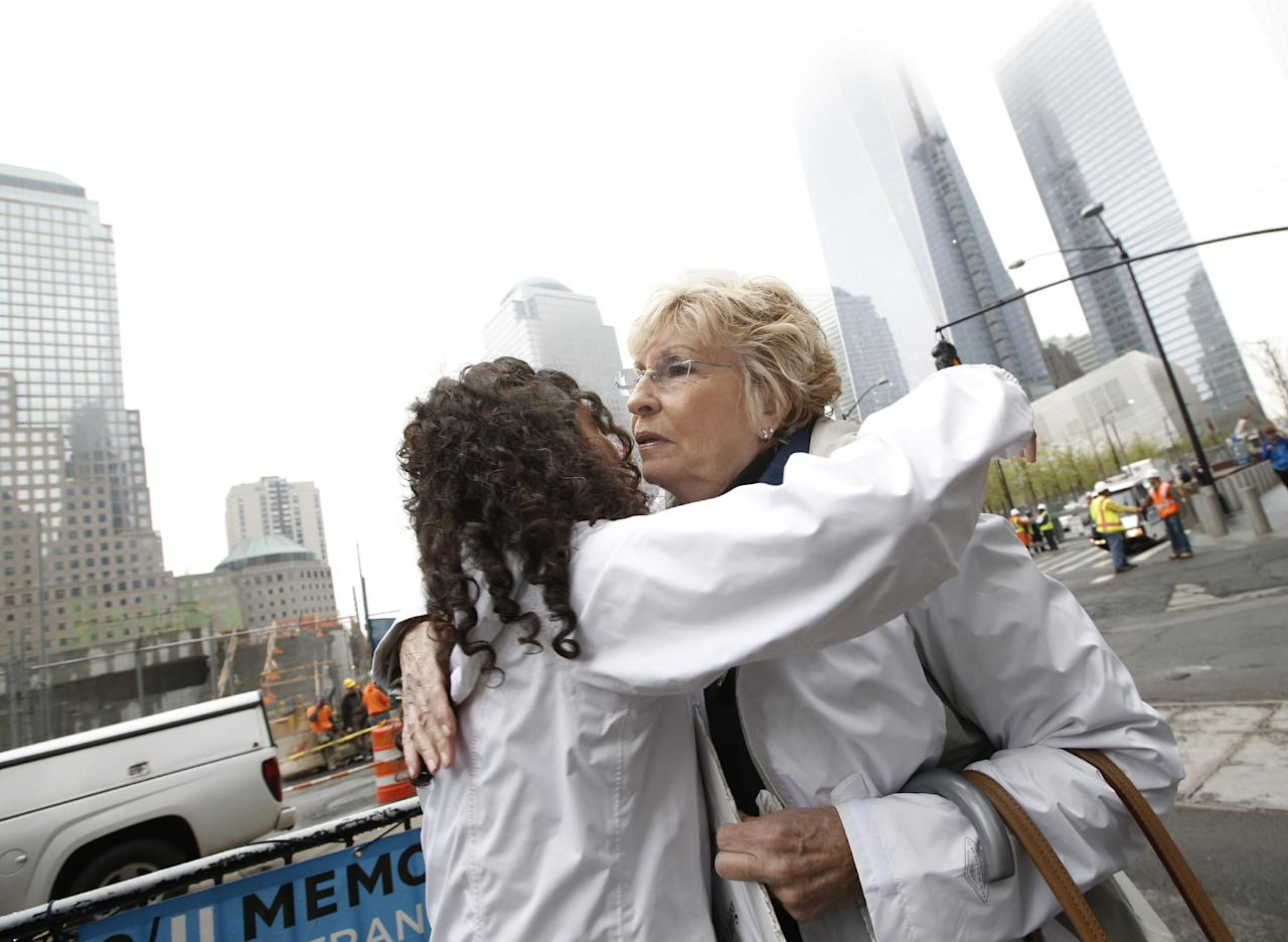 Rosaleen Tallon, left, sister of firefighter Sean Tallon killed in the 9-11 World Trade Center attacks, embraces Rosemary Cain, who lost her son George in the attacks before holding a press conference opposite the National September 11 Memorial & Museum in New York, Thursday, May 8, 2014. The families oppose the display of their loved ones' remains in the basement of the museum as opposed on the memorial plaza level. The families say they weren't consulted about the decision to put the remains in the museum basement that flooded during Superstorm Sandy.The museum opens to the public May 21. (AP Photo/Kathy Willens)