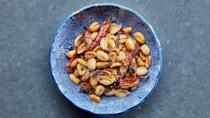 """Tingly Sichuan peppercorns, white pepper, five-spice powder, strips of chiles, and a little salt and sugar make these peanuts a fantastic snack. <a href=""""https://www.epicurious.com/recipes/food/views/mala-fried-peanuts?mbid=synd_yahoo_rss"""" rel=""""nofollow noopener"""" target=""""_blank"""" data-ylk=""""slk:See recipe."""" class=""""link rapid-noclick-resp"""">See recipe.</a>"""