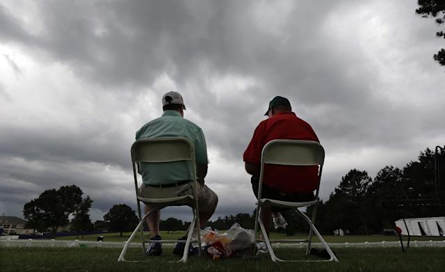 Golf fans watch as a storm rolls in and causes a weather delay during the second round of the St. Jude Classic golf tournament Friday, June 6, 2014, in Memphis, Tenn. (AP Photo/Mark Humphrey)