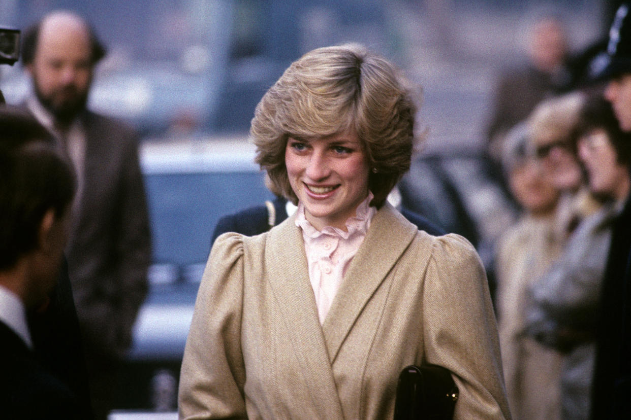 The Princess of Wales wore a ruffle neck blouse when she visited the Department of Health and Social Security in Elephant and Castle, London, on 3 December 1982.  (PA)