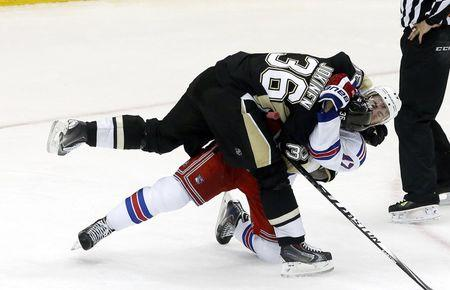May 9, 2014; Pittsburgh, PA, USA; Pittsburgh Penguins left wing Jussi Jokinen (36) and New York Rangers defenseman John Moore (17) tussle during the third period in game five of the second round of the 2014 Stanley Cup Playoffs at the CONSOL Energy Center. The Rangers won 5-1. Mandatory Credit: Charles LeClaire-USA TODAY Sports