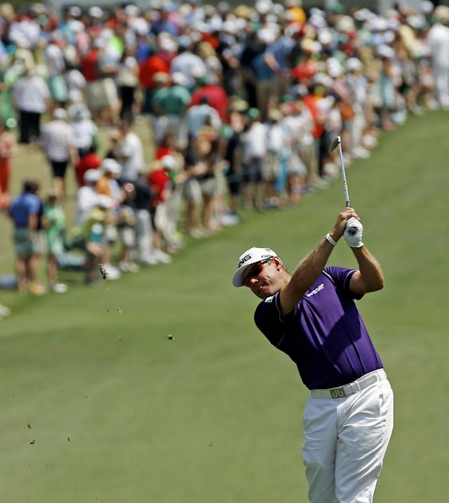 Lee Westwood, of England, watches his second shot on the first fairway during the fourth round of the Masters golf tournament Sunday, April 13, 2014, in Augusta, Ga. (AP Photo/David J. Phillip)