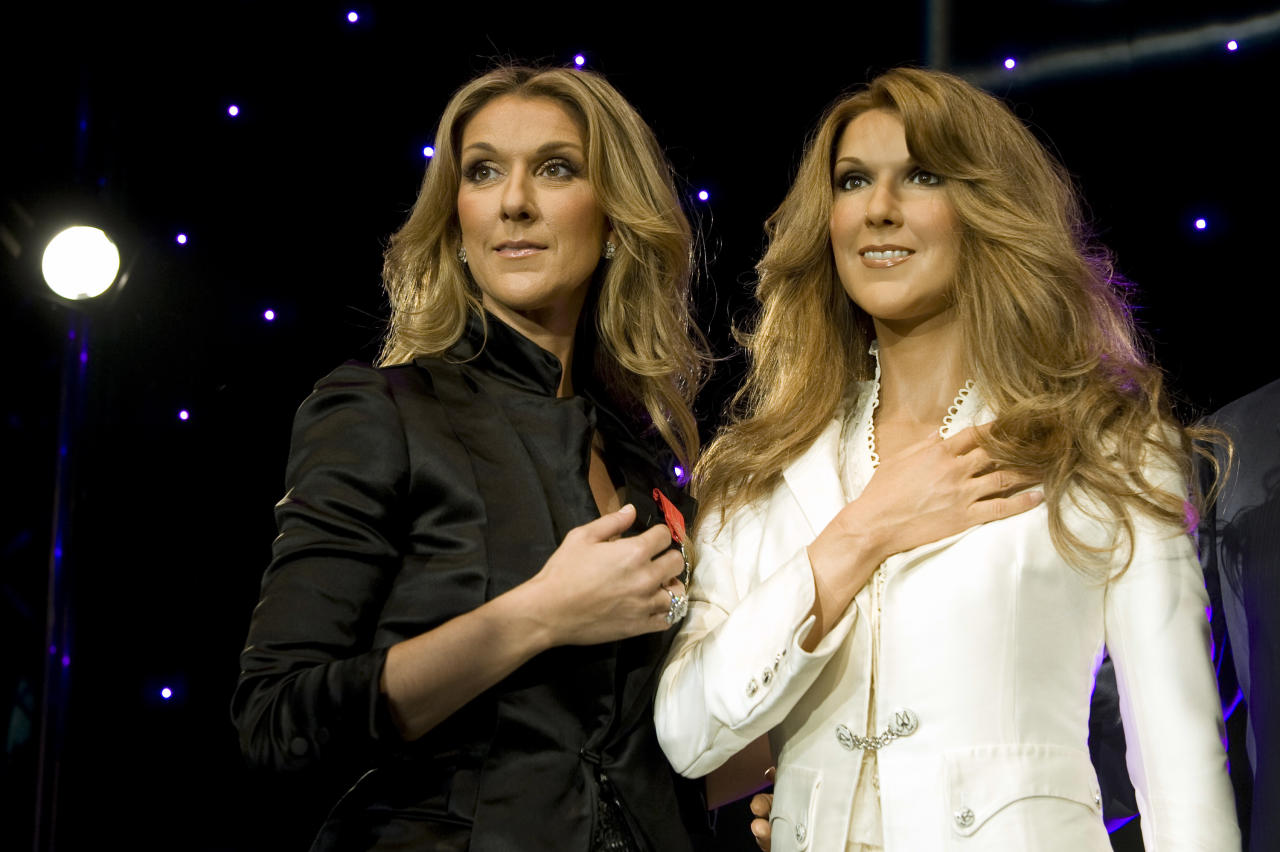 Singer Celine Dion (L) stands next to her figure at the Grevin wax museum during the presentation of her waxwork in Paris May 22, 2008. REUTERS/ Gonzalo Fuentes