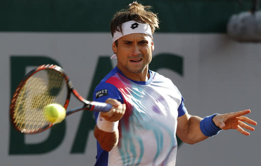 Spain's David Ferrer returns the ball to compatriot Rafael Nadal during their quarterfinal match of the French Open tennis tournament at the Roland Garros stadium, in Paris, France, Wednesday, June 4, 2014. (AP Photo/Michel Euler)