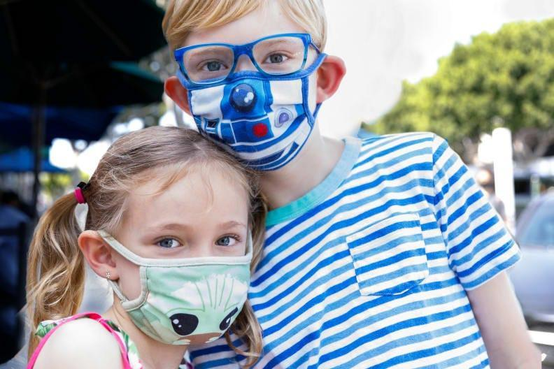 They'll fit right in at Disneyland with Disney-themed cloth face masks.