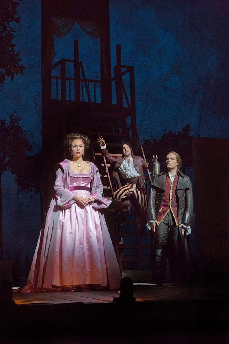 """In this Dec. 14, 2012 publicity photo, from left, Isabel Leonard as Rosina, Rodion Pogossov as Figaro and Alek Shrader as Count Almaviva are seen in Rossini's """"The Barber of Seville,"""" during rehearsal at the Metropolitan Opera in New York. (AP Photo/Metropolitan Opera, Ken Howard)"""